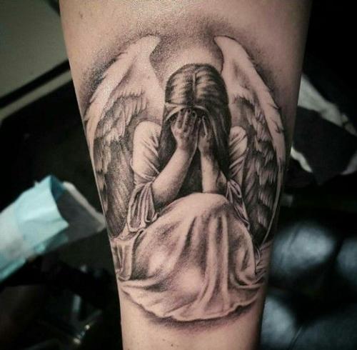 hình xăm thiên thần kín lưng